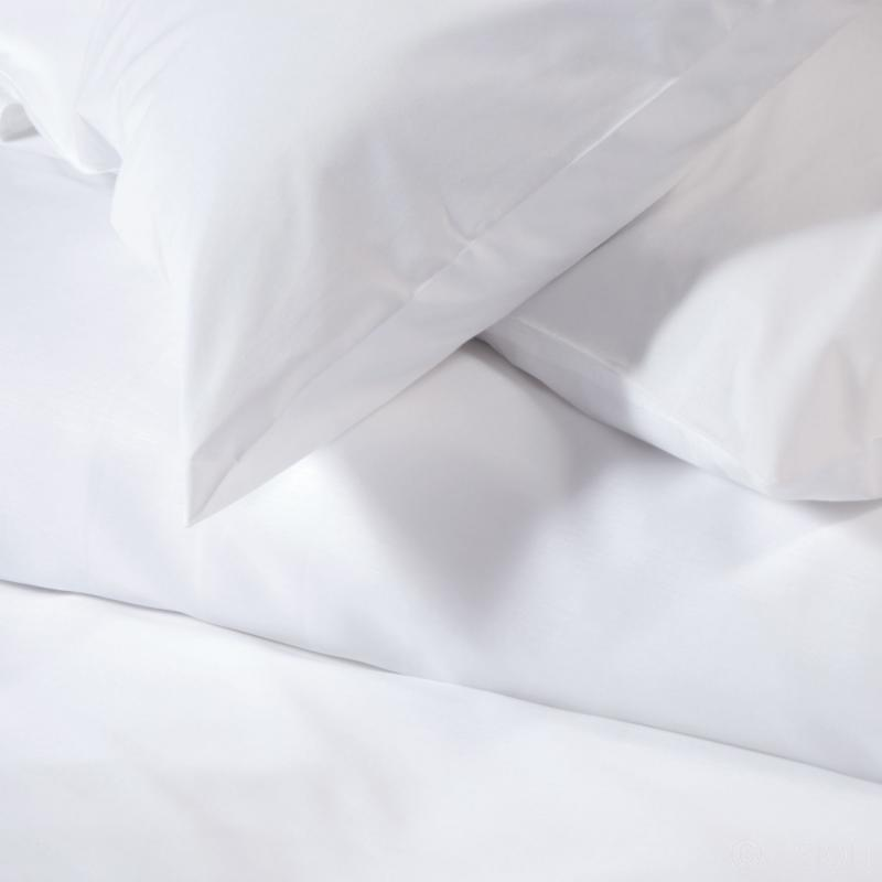 White flat bed sheets detail