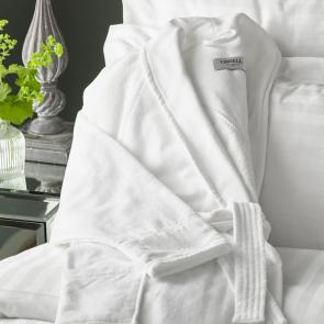 Vermont white luxury bathrobe draped on bed