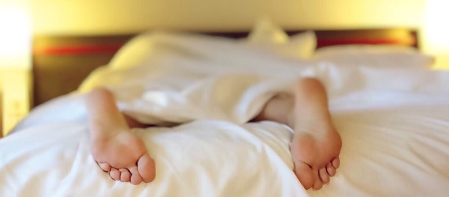 Sleeping with feet hanging off the end of the bed
